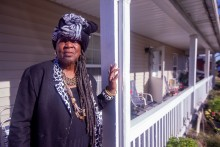 Mamie Cosey, 78, stands on the front porch of her East St. Louis home near the Veolia waste incinerator she blames for making her great-grandchildren sick.